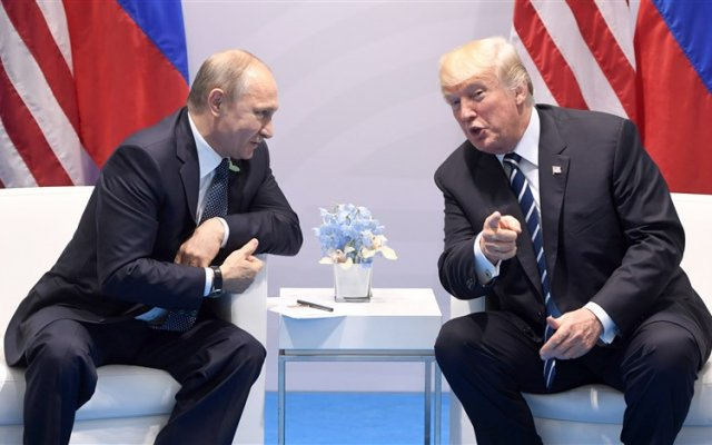 Photo of Trump Jokes To Putin: Don't Meddle In Elections!