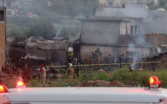 Photo of Pakistan Army Plane Crashes Into Residential Area Killing 18