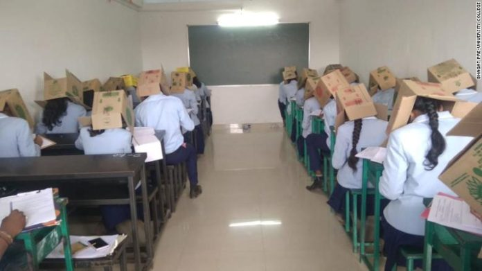 Photo of Indian Students Wear Boxes On Their Heads During Exam To Prevent Cheating