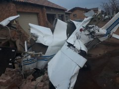 Photo of Plane Crashes Into House In South Africa