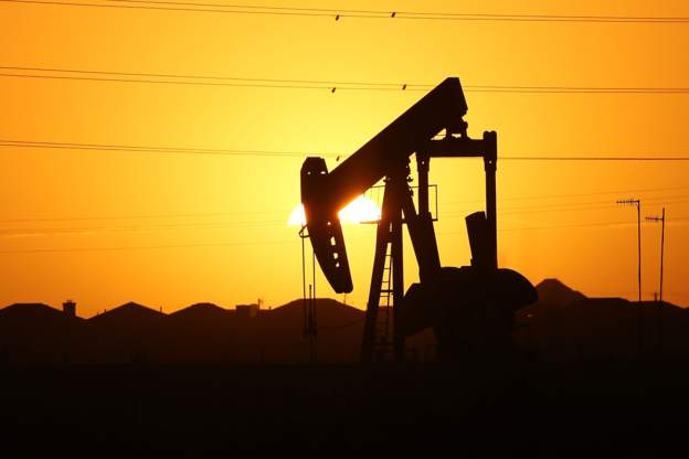 Photo of Oil Falls To Nearly $56 A Barrel, Its Lowest In A Year