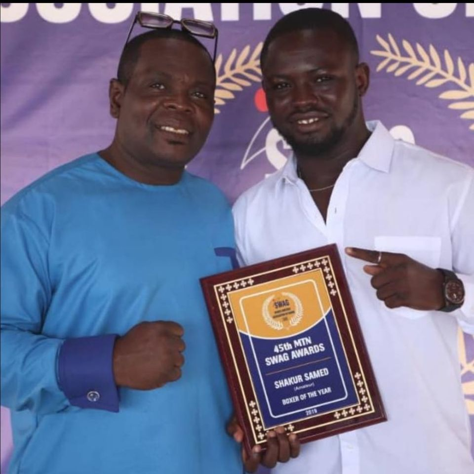 Photo of Black Bomber Trainer Ofori Asare Congratulates Amateur Boxer of the year Shakur Samed.